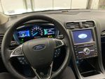 Red[Rapid Red Metallic Tinted Clearcoat] 2020 Ford Fusion Hybrid Steering Wheel and Dash Photo in Dartmouth NS