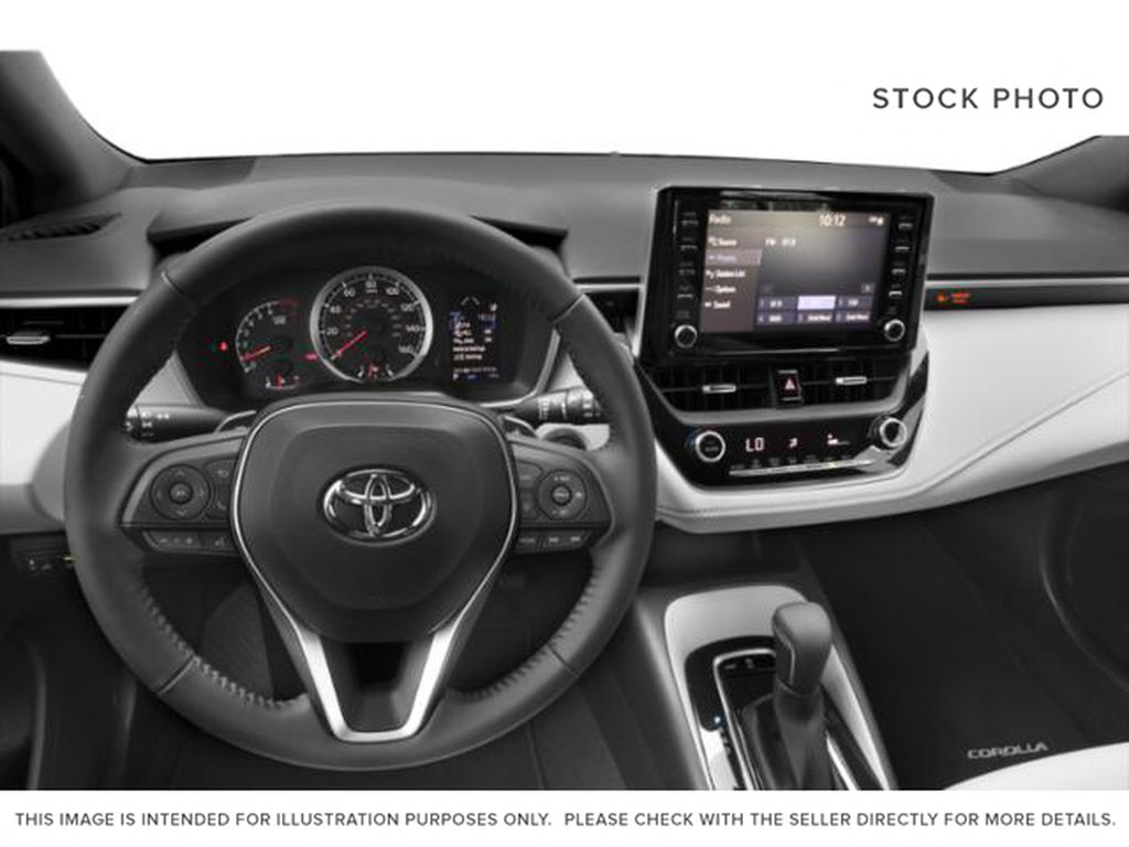 Red[Supersonic Red  w/Black Roof] 2021 Toyota Corolla Hatchback Steering Wheel and Dash Photo in Kelowna BC