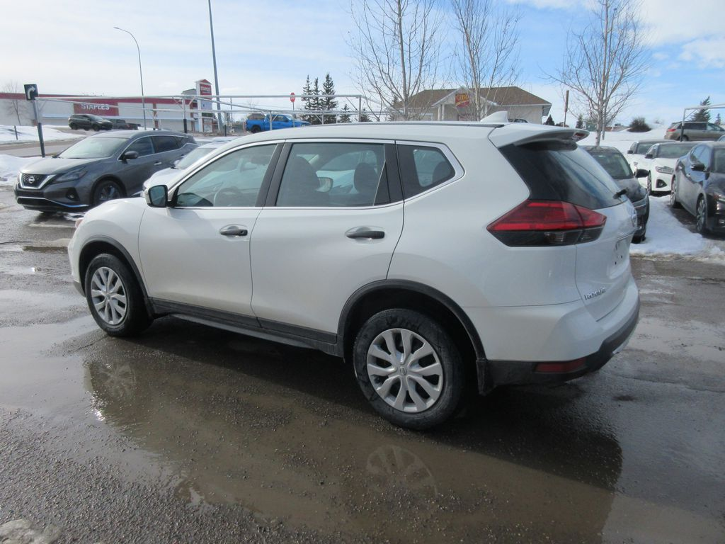 White[Glacier White] 2017 Nissan Rogue Strng Wheel/Dash Photo: Frm Rear in Okotoks AB