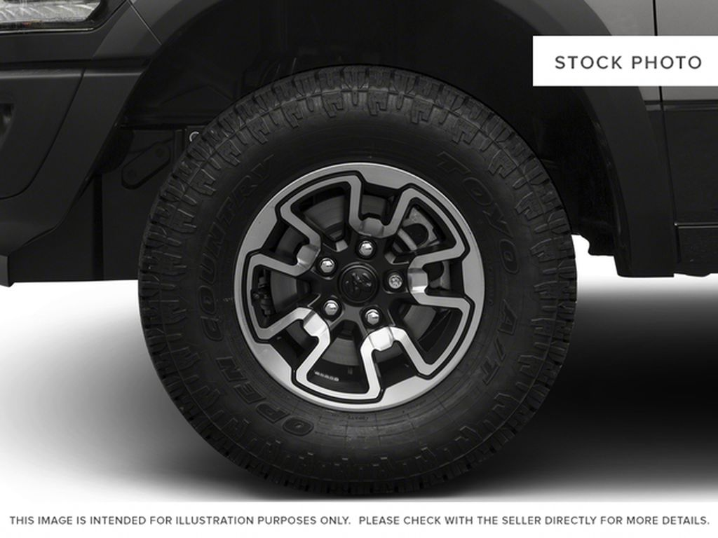 Black[Brilliant Black Crystal Pearl] 2016 Ram 1500 Left Front Rim and Tire Photo in Fort Macleod AB
