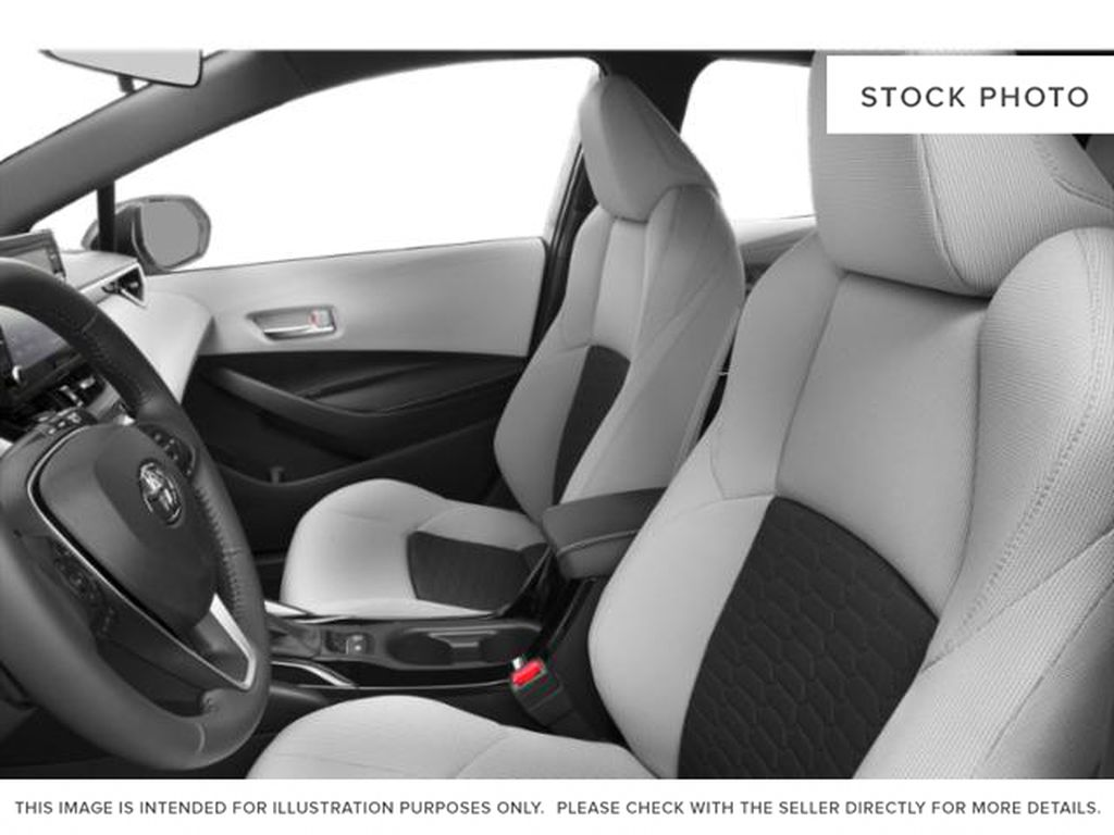 White[Wind Chill Pearl] 2021 Toyota Corolla Hatchback Left Front Interior Photo in Beverly Hills NU