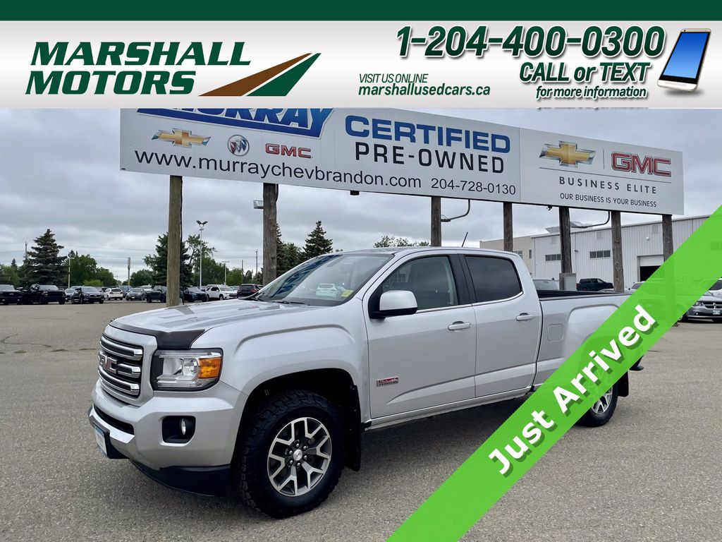 """Silver[Quicksilver Metallic] 2016 GMC Canyon 4WD Crew Cab 128.3"""" SLE *Just Received*"""