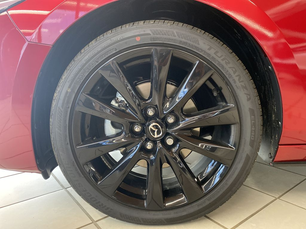 SOUL RED CRYSTAL METALLIC(46V) 2021 Mazda Mazda3 GT Turbo AWD Left Front Rim and Tire Photo in Edmonton AB