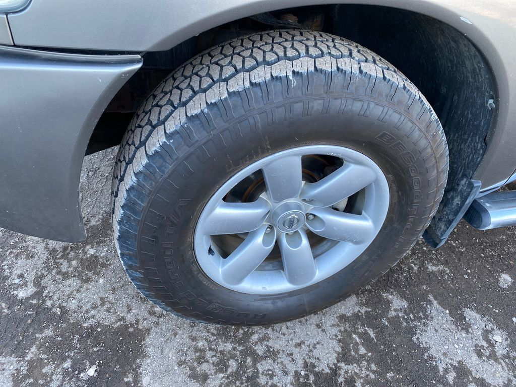 Silver[Pewter Metallic] 2007 Nissan Titan Left Front Rim and Tire Photo in Lethbridge AB