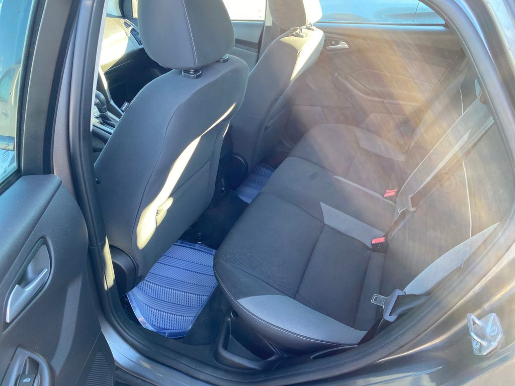 Gray[Sterling Grey Metallic] 2014 Ford Focus Left Side Rear Seat  Photo in Lethbridge AB