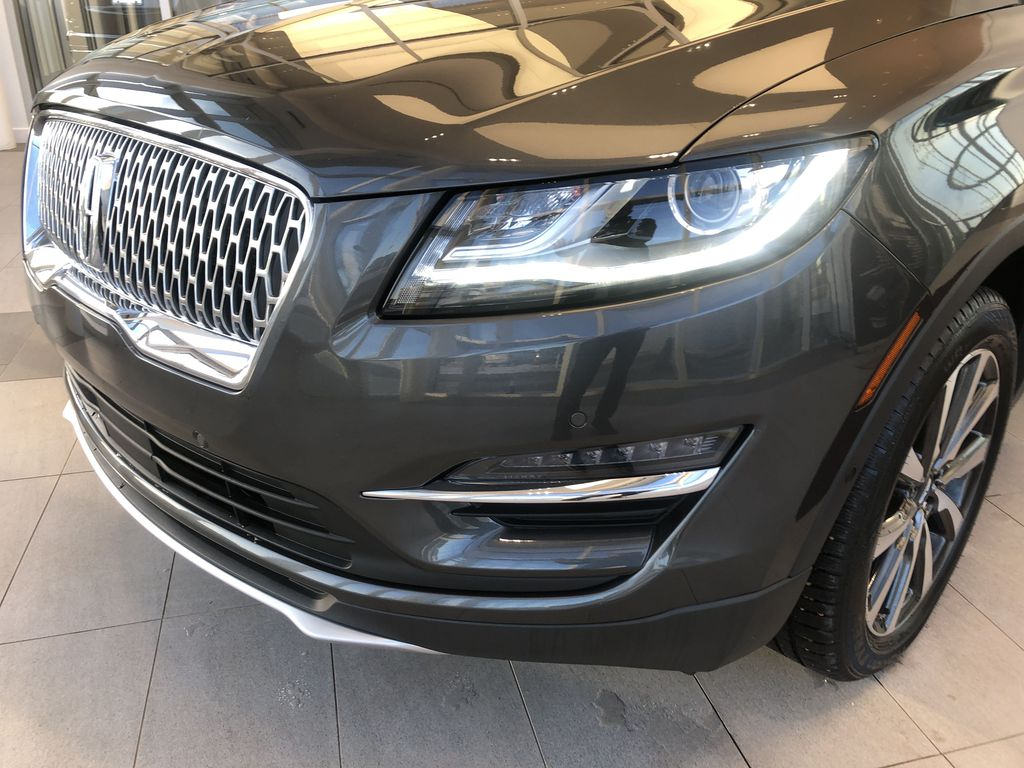 Gray[Magnetic Grey Metallic] 2019 Lincoln MKC Left Front Head Light / Bumper and Grill in Edmonton AB