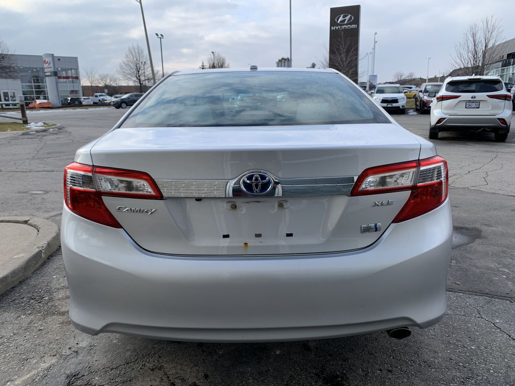 Silver 2014 Toyota Camry Hybrid Left Front Interior Photo in Brampton ON