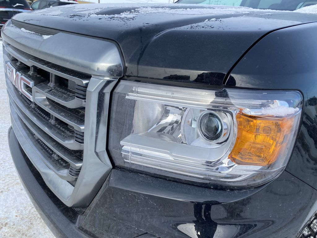 Black[Onyx Black] 2021 GMC Canyon Left Front Head Light / Bumper and Grill in Edmonton AB