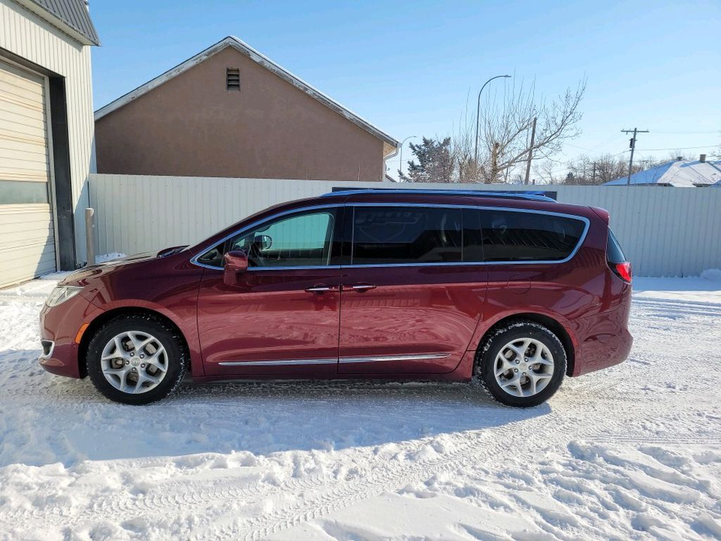 Red 2017 Chrysler Pacifica Left Front Interior Door Panel Photo in Fort Macleod AB