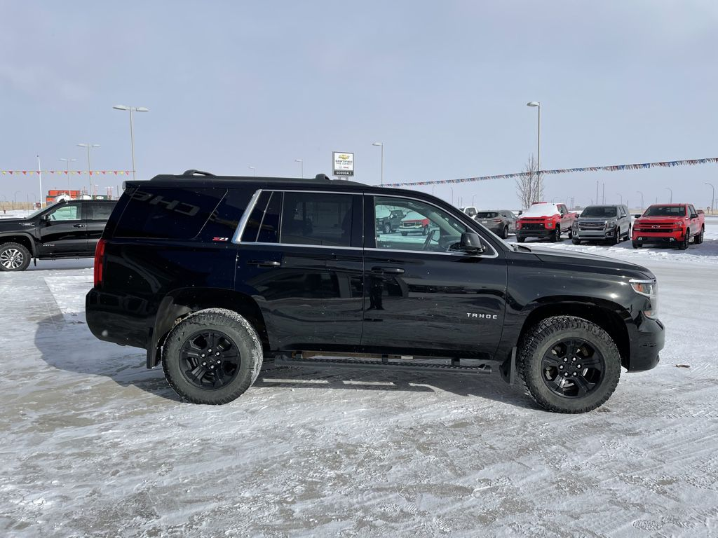 Black[Black] 2017 Chevrolet Tahoe Left Front Rim and Tire Photo in Fort Macleod AB