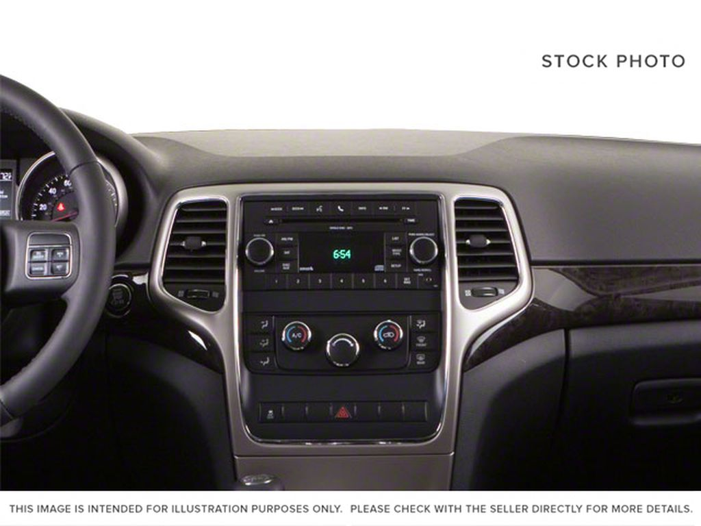 Burgundy 2012 Jeep Grand Cherokee Central Dash Options Photo in Fort Macleod AB