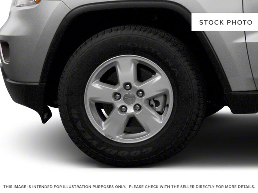Burgundy 2012 Jeep Grand Cherokee Left Front Rim and Tire Photo in Fort Macleod AB