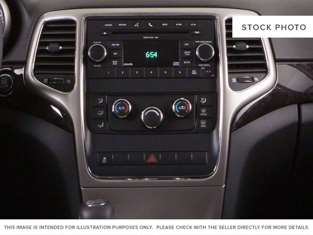 Burgundy 2012 Jeep Grand Cherokee Center Console Photo in Fort Macleod AB