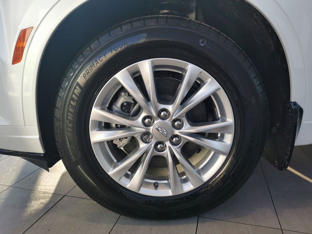 White[Crystal White Tricoat] 2021 Cadillac XT6 Left Front Rim and Tire Photo in Edmonton AB
