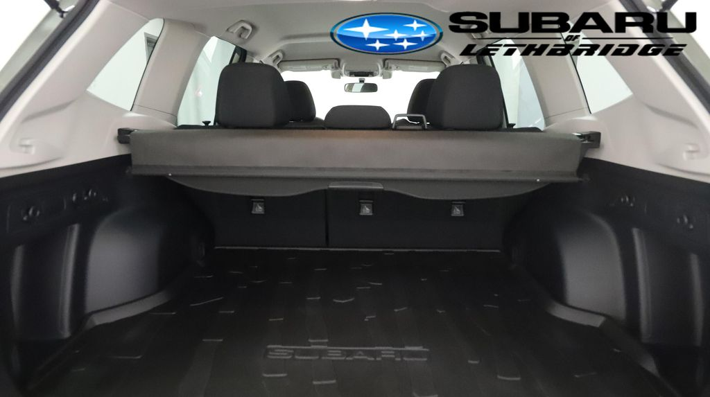 Green 2021 Subaru Forester Left Front Interior Photo in Lethbridge AB