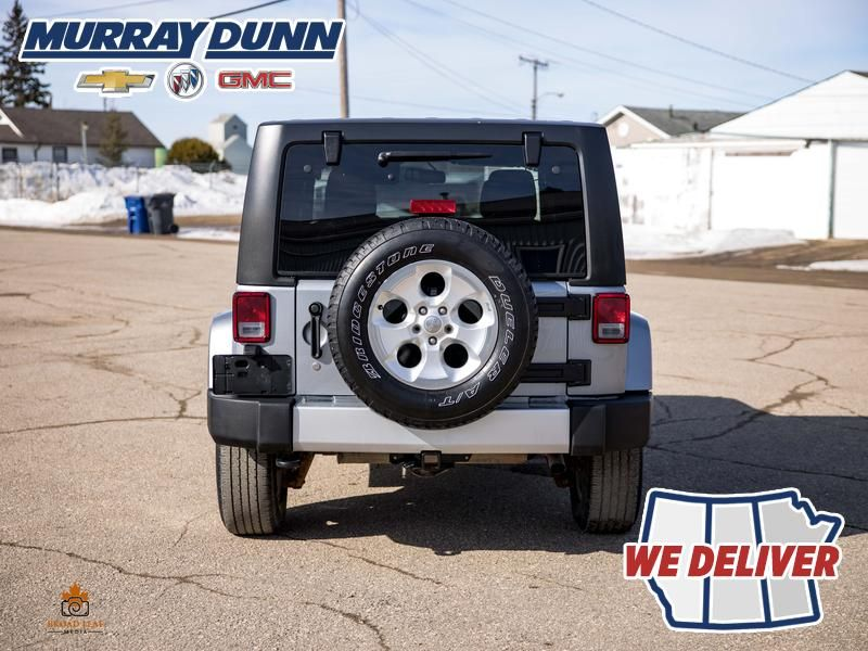 Black[Black] 2015 Jeep Wrangler Unlimited sahara Rear of Vehicle Photo in Nipawin SK