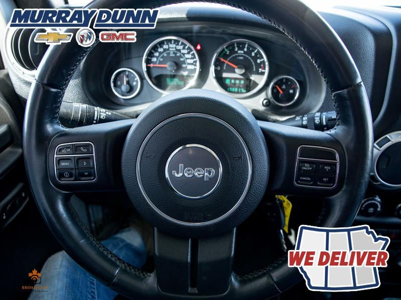 Black[Black] 2015 Jeep Wrangler Unlimited sahara Steering Wheel and Dash Photo in Nipawin SK