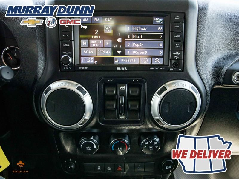 Black[Black] 2015 Jeep Wrangler Unlimited sahara Central Dash Options Photo in Nipawin SK