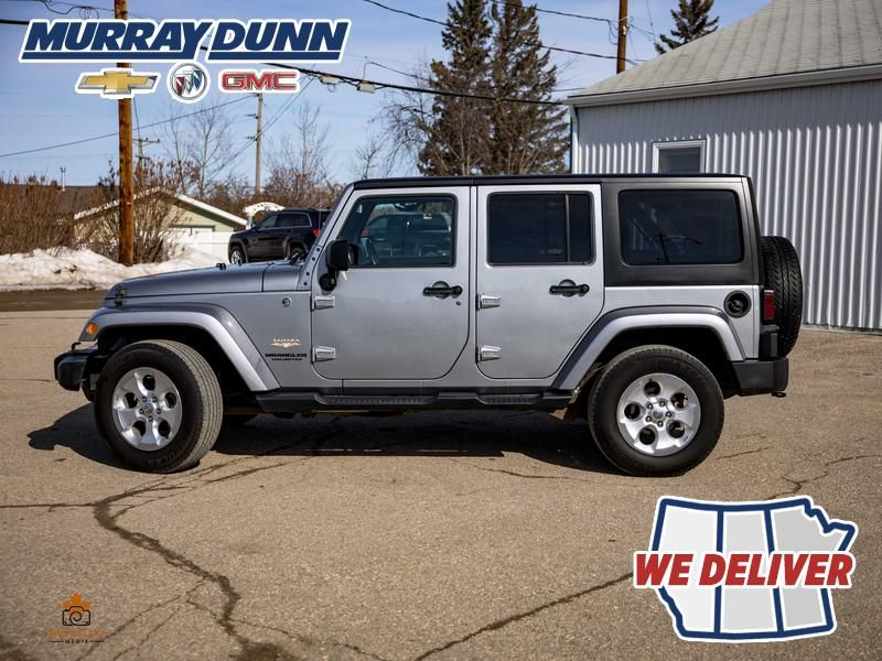 Black[Black] 2015 Jeep Wrangler Unlimited sahara Left Side Photo in Nipawin SK