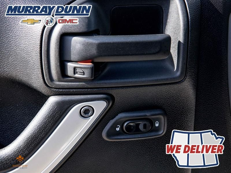 Black[Black] 2015 Jeep Wrangler Unlimited sahara  Driver's Side Door Controls Photo in Nipawin SK