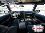 Black[Black] 2015 Jeep Wrangler Unlimited sahara Steering Wheel Photo: Full View in Nipawin SK