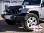 Black[Black] 2015 Jeep Wrangler Unlimited sahara Left Front Rim and Tire Photo in Nipawin SK