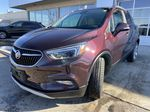 Maroon[Black Cherry Metallic] 2017 Buick Encore Essence Left Front Head Light / Bumper and Grill in Calgary AB