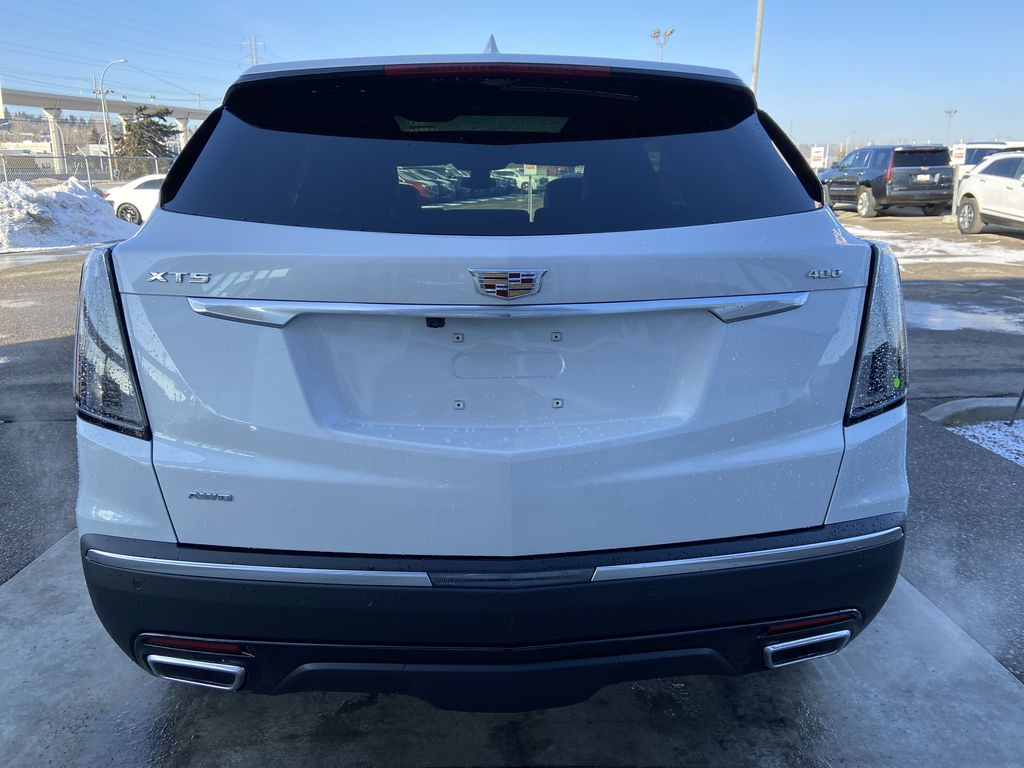 White[Crystal White Tricoat] 2021 Cadillac XT5 Sport Rear of Vehicle Photo in Calgary AB