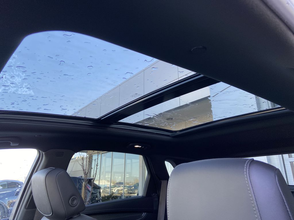 White[Crystal White Tricoat] 2021 Cadillac XT5 Sport Sunroof Photo in Calgary AB