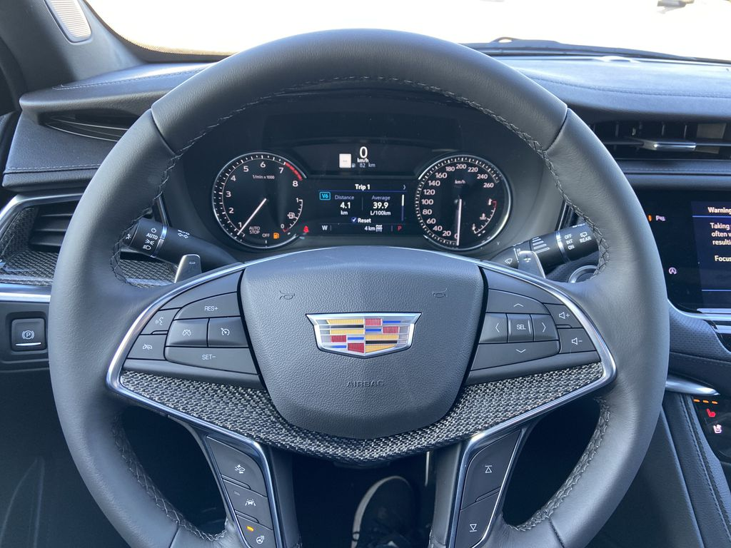 White[Crystal White Tricoat] 2021 Cadillac XT5 Sport Steering Wheel and Dash Photo in Calgary AB