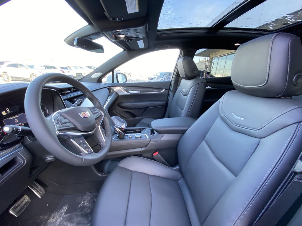 White[Crystal White Tricoat] 2021 Cadillac XT5 Sport Left Front Interior Photo in Calgary AB