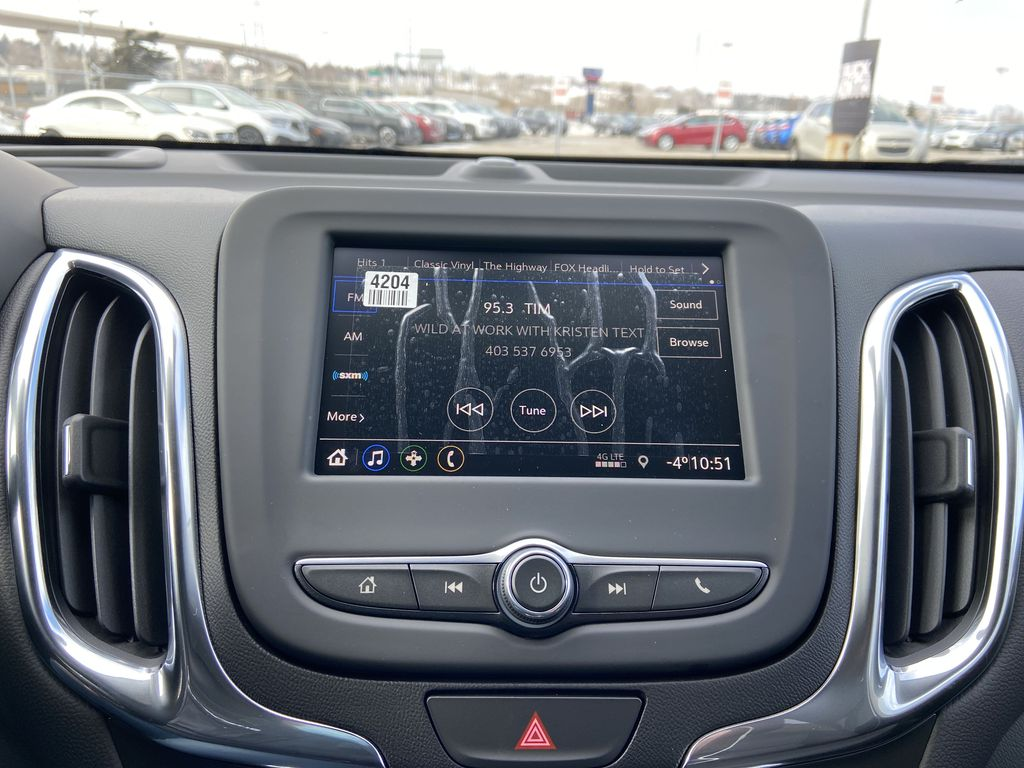 Red[Cajun Red Tintcoat] 2021 Chevrolet Equinox LT Radio Controls Closeup Photo in Calgary AB