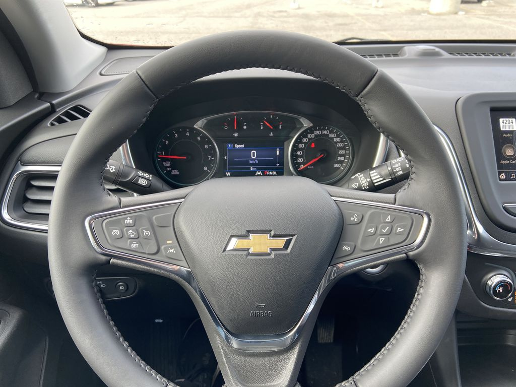 Red[Cajun Red Tintcoat] 2021 Chevrolet Equinox LT Steering Wheel and Dash Photo in Calgary AB