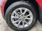 Red[Cajun Red Tintcoat] 2021 Chevrolet Equinox LT Left Front Rim and Tire Photo in Calgary AB