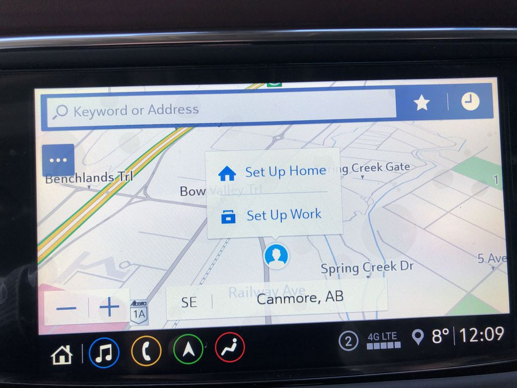 White[White Frost Tricoat] 2021 Buick Enclave Avenir Navigation Screen Closeup Photo in Canmore AB
