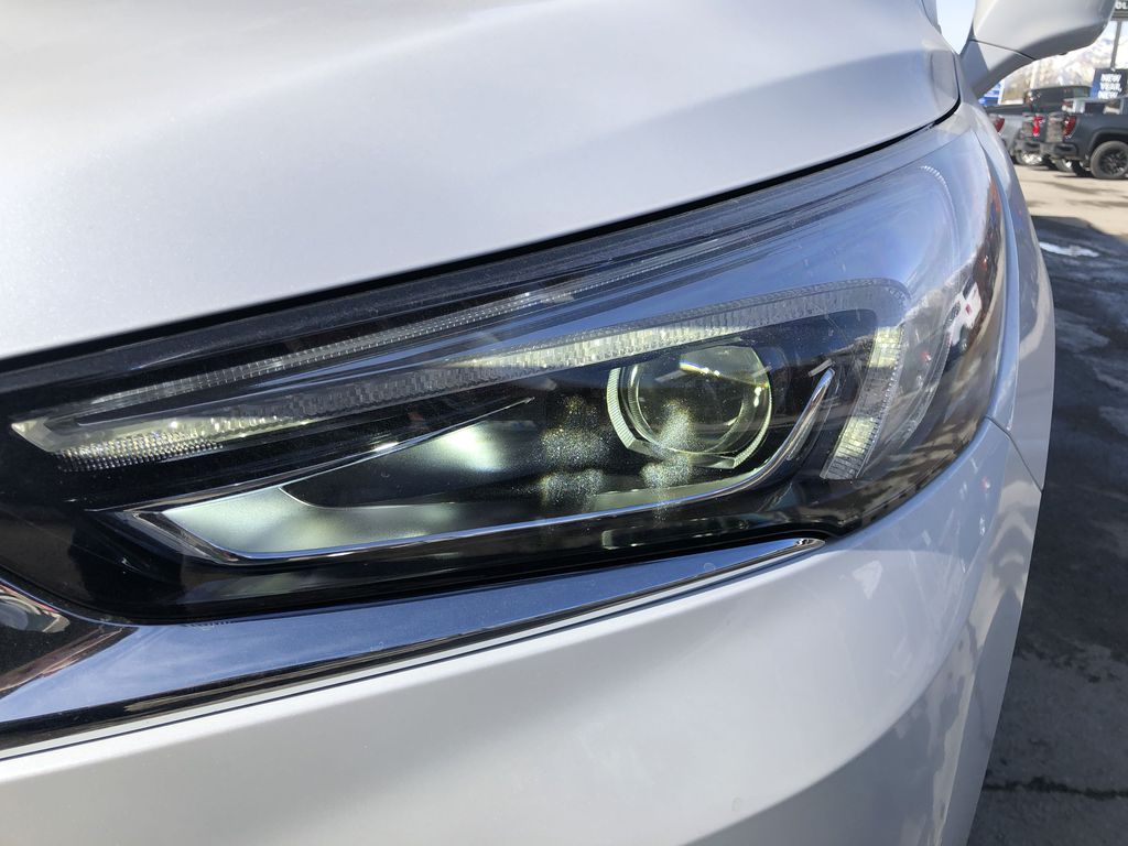 White[White Frost Tricoat] 2021 Buick Enclave Avenir Left Front Head Light / Bumper and Grill in Canmore AB