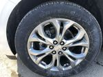 White[White Frost Tricoat] 2021 Buick Enclave Avenir Left Front Rim and Tire Photo in Canmore AB
