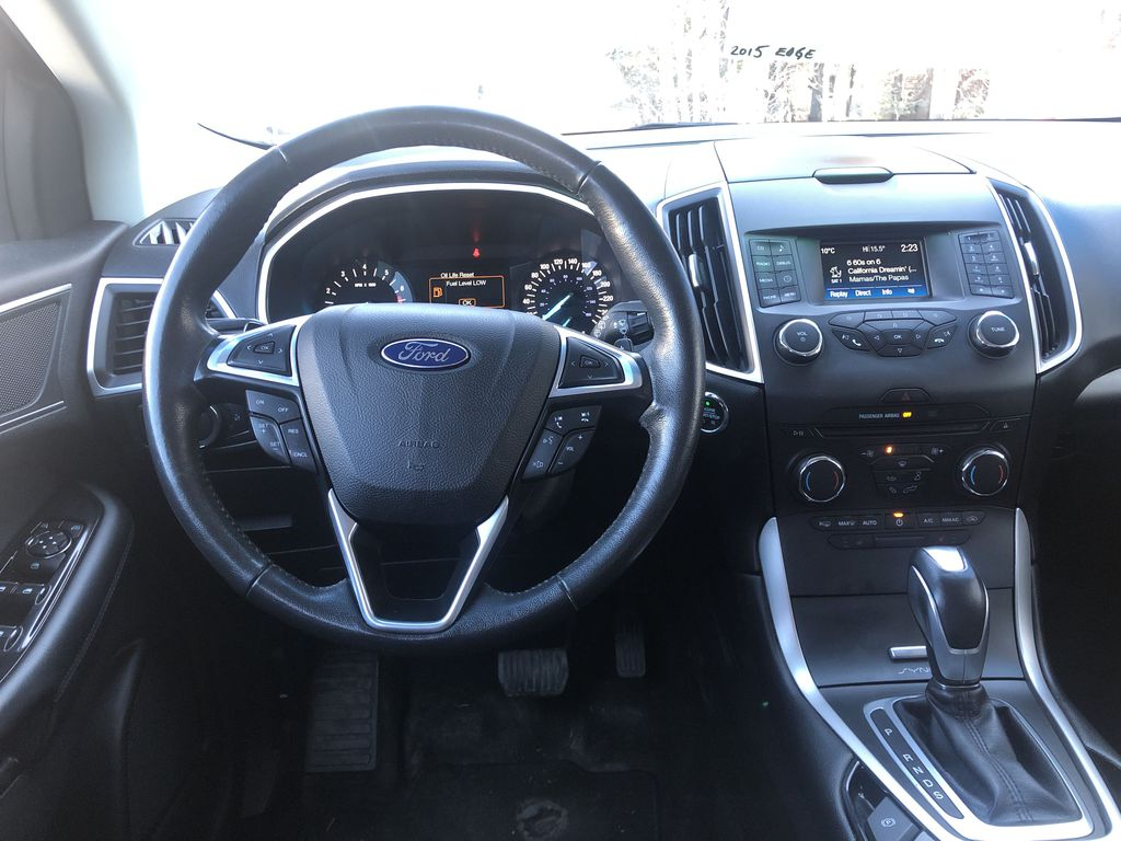 Gray[Magnetic Metallic] 2015 Ford Edge SEL Strng Wheel/Dash Photo: Frm Rear in Canmore AB