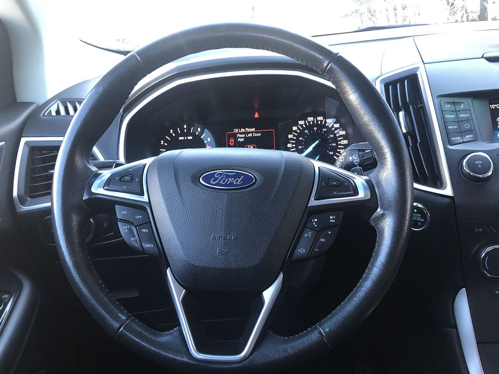 Gray[Magnetic Metallic] 2015 Ford Edge SEL Strng Wheel: Frm Rear in Canmore AB
