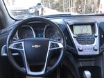 Black[Black] 2012 Chevrolet Equinox Strng Wheel/Dash Photo: Frm Rear in Canmore AB