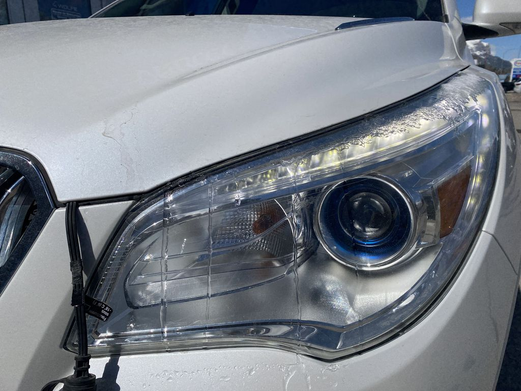 White[White Frost Tricoat] 2017 Buick Enclave Left Front Head Light / Bumper and Grill in Canmore AB