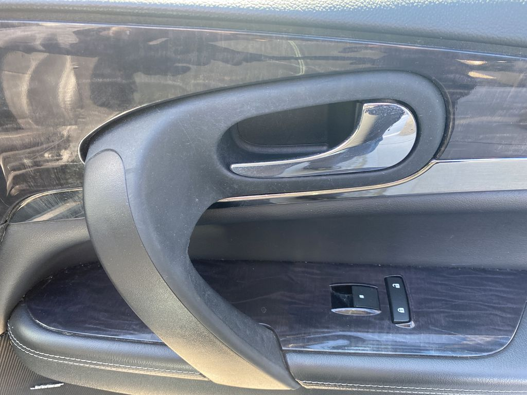 White[White Frost Tricoat] 2017 Buick Enclave Passenger Front Door Controls Photo in Canmore AB