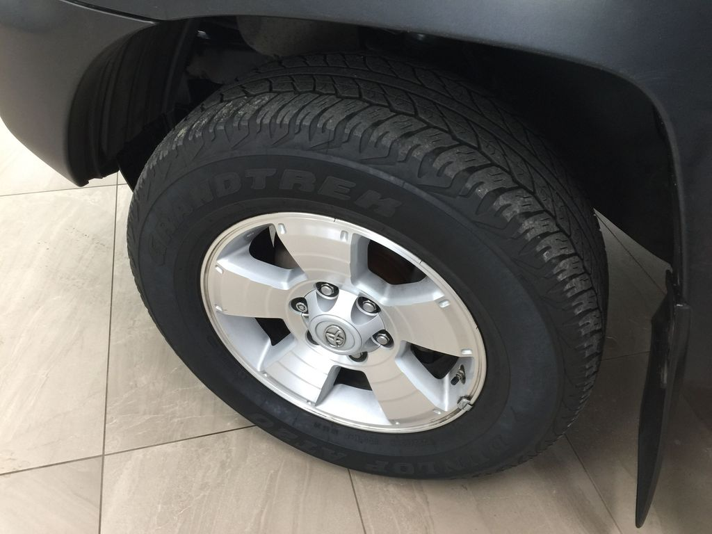 Silver[Silver Streak Mica] 2012 Toyota Tacoma SR5 Double Cab 4x4 Left Front Rim and Tire Photo in Sherwood Park AB