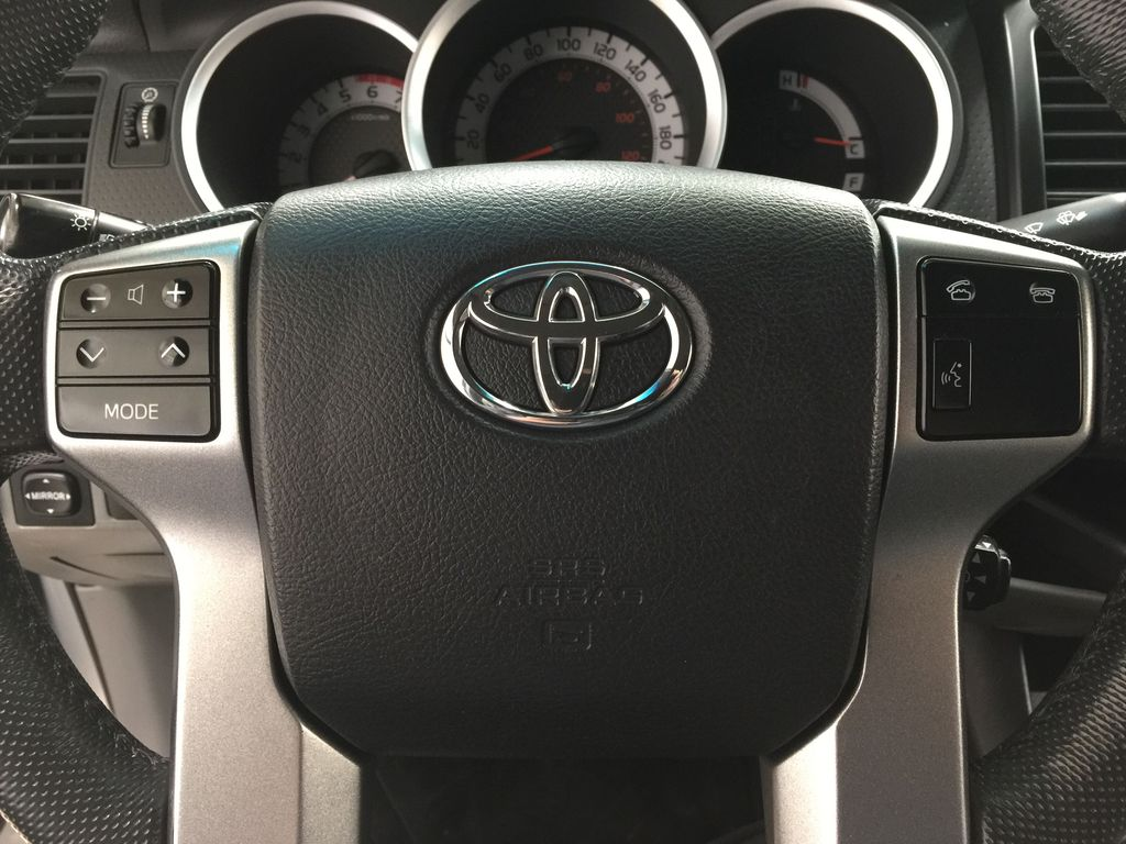 Silver[Silver Streak Mica] 2012 Toyota Tacoma SR5 Double Cab 4x4 Steering Wheel and Dash Photo in Sherwood Park AB