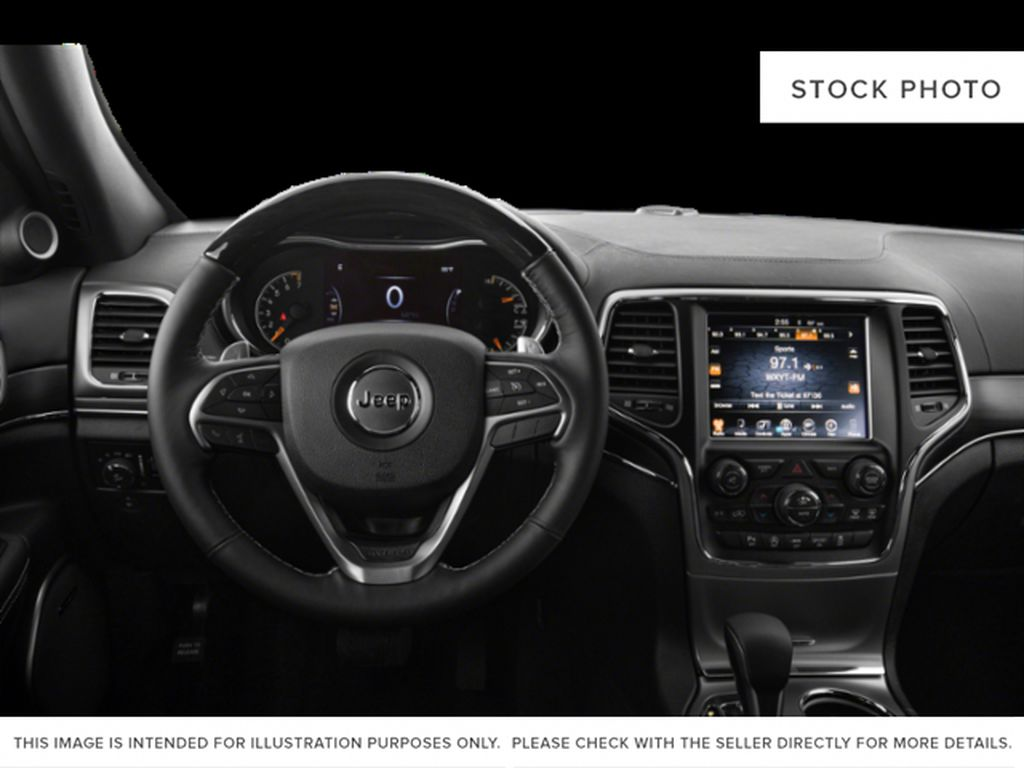White[Bright White] 2018 Jeep Grand Cherokee Steering Wheel and Dash Photo in Fort Macleod AB