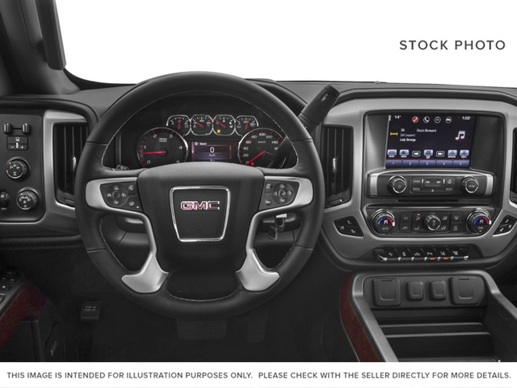 Red[Cardinal Red] 2016 GMC Sierra 2500HD Steering Wheel and Dash Photo in Fort Macleod AB