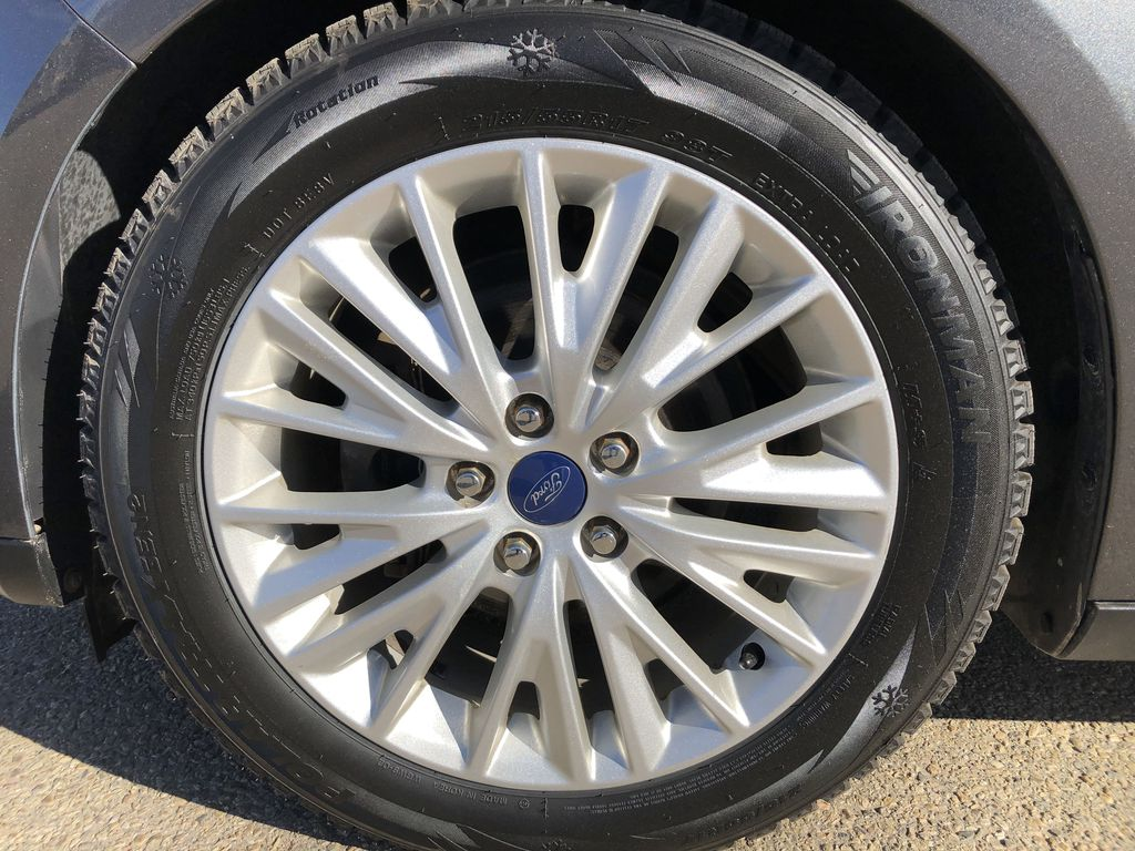 Gray[Magnetic Metallic] 2015 Ford Focus Left Front Rim and Tire Photo in Edmonton AB