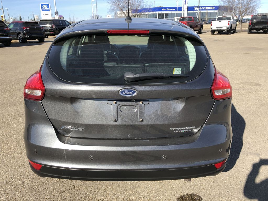 Gray[Magnetic Metallic] 2015 Ford Focus Rear of Vehicle Photo in Edmonton AB