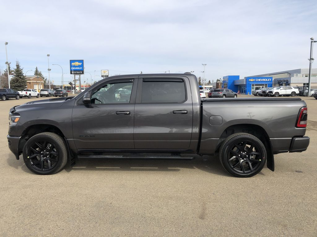 Gray[Granite Crystal Metallic] 2020 Ram 1500 Left Side Photo in Edmonton AB