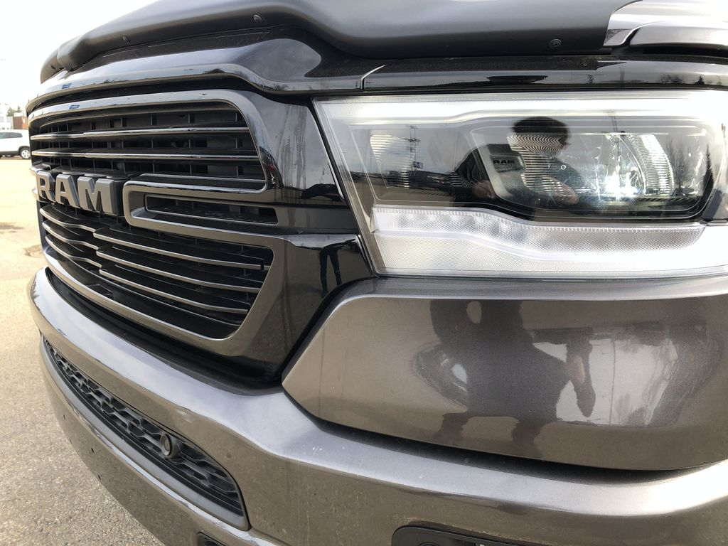 Gray[Granite Crystal Metallic] 2020 Ram 1500 Left Front Head Light / Bumper and Grill in Edmonton AB